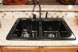 rubbed bronze kitchen sink faucet delta trinsic faucet in chagne bronze kitchen by design
