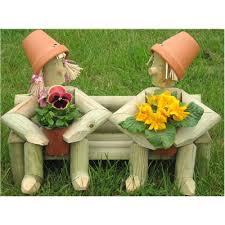 wooden garden flowerpot two on a bench with fresh plants