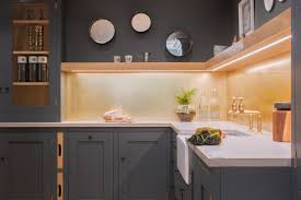 concrete alternative sustainable kitchens view of l shaped kitchen painted in farrow ball down pipe with brushed brass