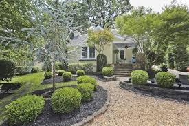 1930s east lake bungalow boasts carriage house backyard u0027paradise