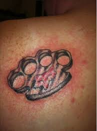 brass knuckles and a clothing company bad by bad tattoos
