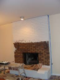 decor painted white brick fireplace with recessed lighting and