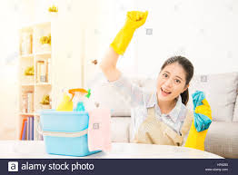 happy woman hand up to celebrate finished the house cleaning stock
