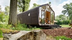 compact tiny house expands in size to offer more living space