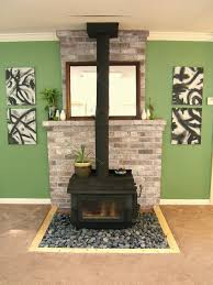 nine red river rock fireplace