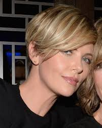 the blonde short hair woman on beverly hills housewives charlize theron and guest attend the launch of vallure vodka at