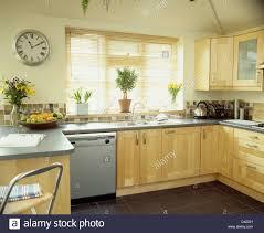 modern kitchen clock circular wall clock in modern pale wood kitchen with granite