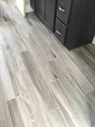 newly installed gray weathered wood plank tile flooring mudroom newly installed gray weathered wood plank tile flooring mudroom foyer ideas bathroom