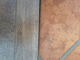 wood floor adjoining terra cotta tile floor