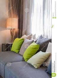 Pillows For Grey Sofa Grey Sofa With Green Pillows In Living Room Stock Photo Image