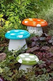 diy garden mushroom made with terra cotta pots and drain trays