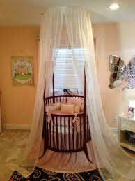 Nursery Rug Ideas Bedroom Brown Round Cribs With Sheer Fabric And Rug For Nursery