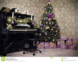 vintage room with a piano christmas tree candles gifts or pr