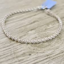 tennis bracelet white images Three prong basket set diamond tennis bracelet in white jpg