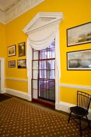check out the two sets of triple sashes in the tall window in