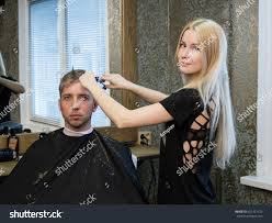 woman barber making mans haircut scissors stock photo 421421152