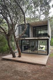 tiny house deck compact summer home hidden in the argentinian forest compact