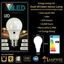 light bulbs with sensors low energy branded low energy cfl dusk to dawn sensor photocell light bulb