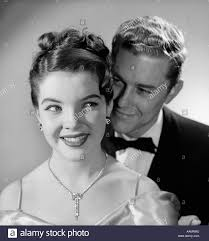 1960 s earrings 1950s 1960s smiling happy woman diamond necklace earrings