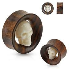 pair of carved skull bone organic wood ear gauges plugs saddles