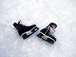 file ice hockey skates on ice jpg wikimedia commons