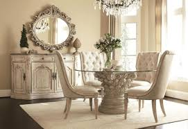 impressive glass dining table and white leather chairs swirl round