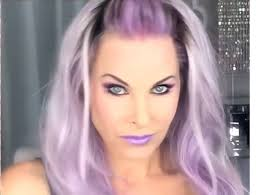 grey streaks in hair woman adds purple streaks to her gray hair minutes later stunning