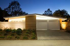 exterior elegant eichler homes with white garage doors and