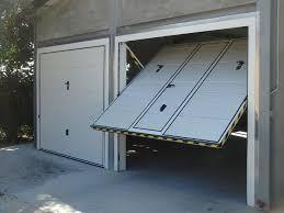 porte per box auto prezzi preventivo porta basculante standard per garage bologna foto