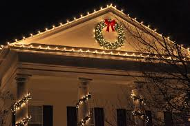 how to hang christmas lights on gutters how to hang christmas lights when you have gutter helmet gutter