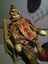 evil rag doll spirit halloween evil looking antique clown doll sitting on a chair nightmare
