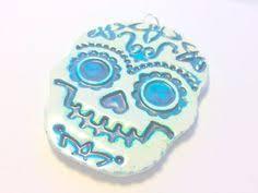 sugar skull ornament faux ceramic blue green glitter and white