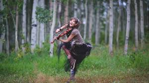 download 2560x1440 lindsey stirling jumping in the woods wallpaper
