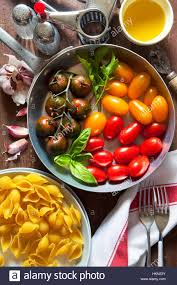 ingredients for pasta salad colorful tomatoes onion garlic