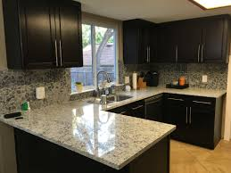 maple kitchen cabinets with white granite countertops slideshow