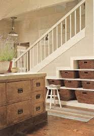 stair basket with circular mirror staircase beach style and