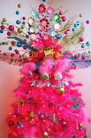 pink christmas tree hot pink christmas tree with colorful tree topper pictures photos