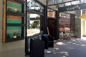 the owner of vinyl cafe in perkins street says she has had windows