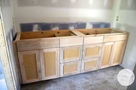 how to paint unfinished cabinets master and shared bathroom custom cabinets flip 1