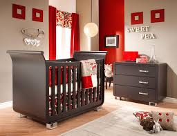 sweet pea nursery khaki walls red accents and espresso colored