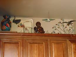 What To Put Above Kitchen Cabinets by Kitchen Decorating Above Kitchen Cabinets By Employing The