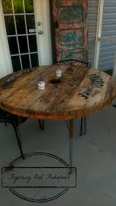 patio table made from cable spool and an old student desk large