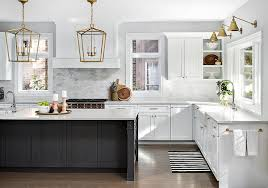 black island and white cabinets kitchen antique brass lanterns with black island transitional