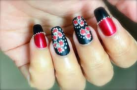 red and black matte nail design with dot flowers and silver