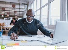 Free Resume Critique African Man Busy Working At Is Desk Stock Photo Image 51185507