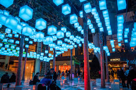 up in lights colorful lanterns shine over winter garden