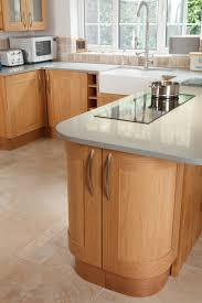 in this solid oak shaker style kitchen an overhanging worktop and
