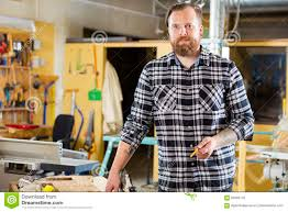 environmental portrait of carpenter in a workshop stock photo