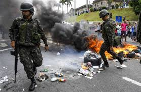 chaos swells amid police strike in brazil state wsj