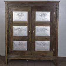 custom punched tin jelly cupboard by village furniture maker
